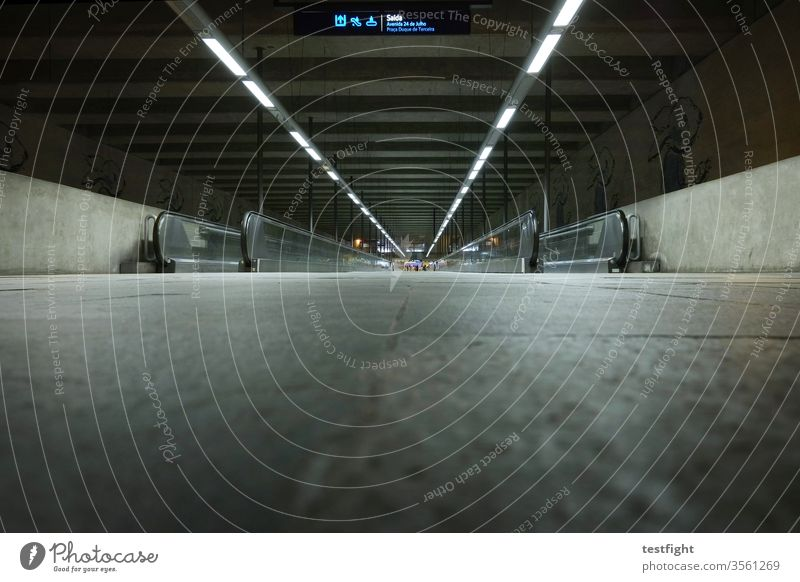 Subway station Underground taxiway Promotion Local traffic Transport City Corridor conceit Deep Light Artificial light far afar Long off Ground Concrete