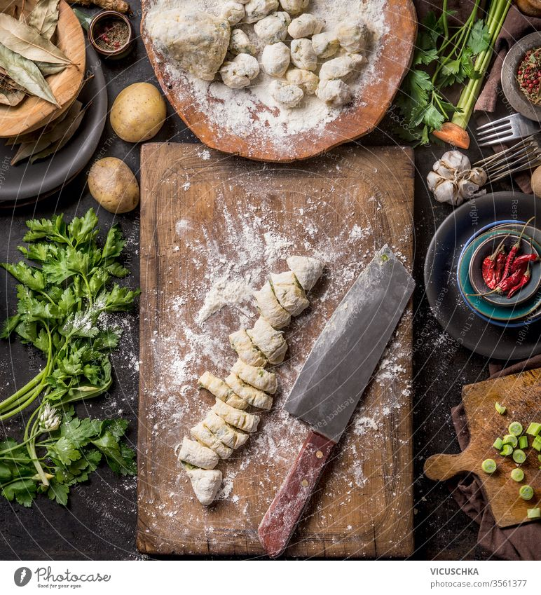 Homemade gnocchi preparation on rustic kitchen table with ingredients. Top view. Potatoes dough . Italian food concept. homemade top view potatoes wooden