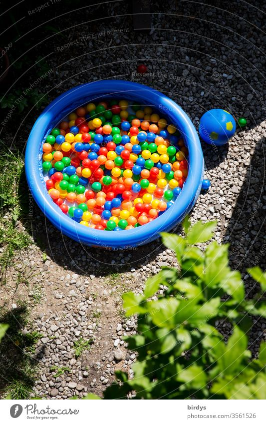 Ball bath. Many colourful balls in a paddling pool for children ball bath variegated Paddling pool Infancy Playing Swimming pool Summer multicoloured ball pool
