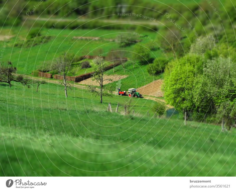 Tractor on the field Tilt-Shift Agriculture Field Valley Meadow huts spring peasant Nature