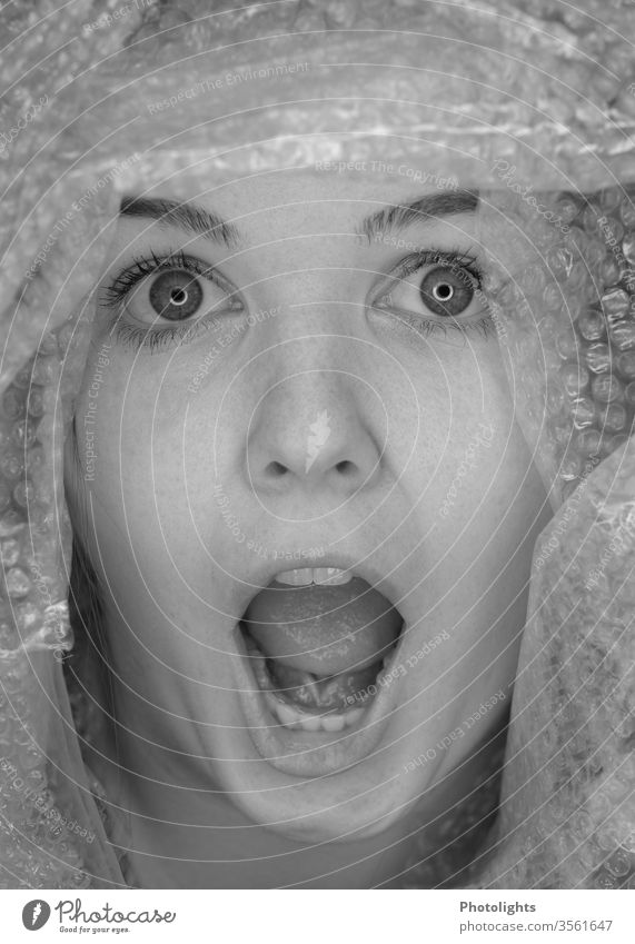 Young woman surprised or startled? Scream 18 - 30 years Interior shot Fear Panic peer big eyes Teeth Mouth Mouth open Face portrait Nose Lips Human being Eyes