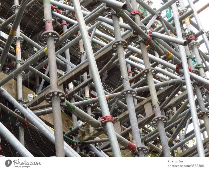 scaffolding Scaffold Metal Construction site Silver Crossbeam Connection muddled metal pipe Pattern tight Scaffolding Workplace Colour photo Deserted