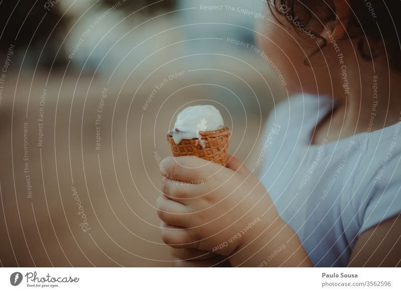 Child holding ice cream Ice cream gelato Summer Ice-cream cone Colour photo Ice cream ball Dessert Eating Food Waffle Candy Sweet Nutrition Delicious