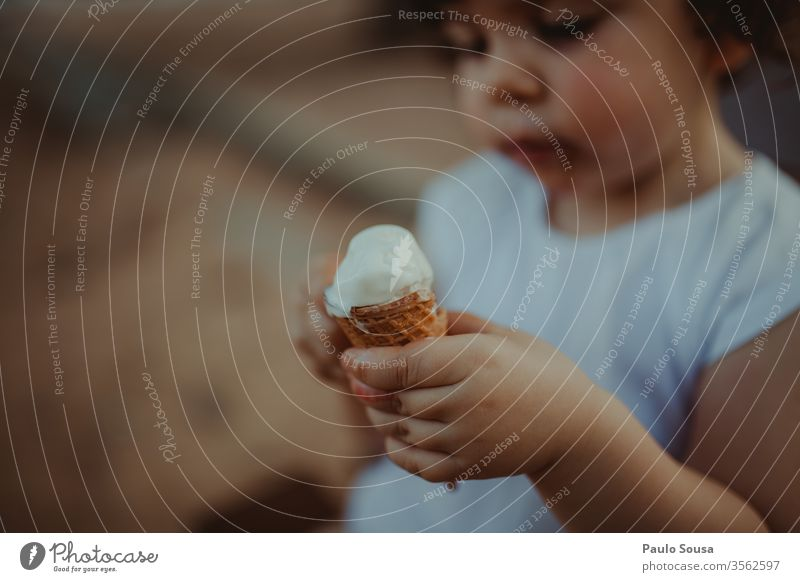 Child holding ice cream Ice cream Ice-cream cone Summer Nutrition Candy To enjoy Ice cream ball Dessert Waffle Food Delicious Colour photo Eating