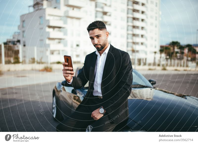 Attractive businessman with convertible car automobile person people young driver traffic vehicle screen assistance fashion phone internet call talking success