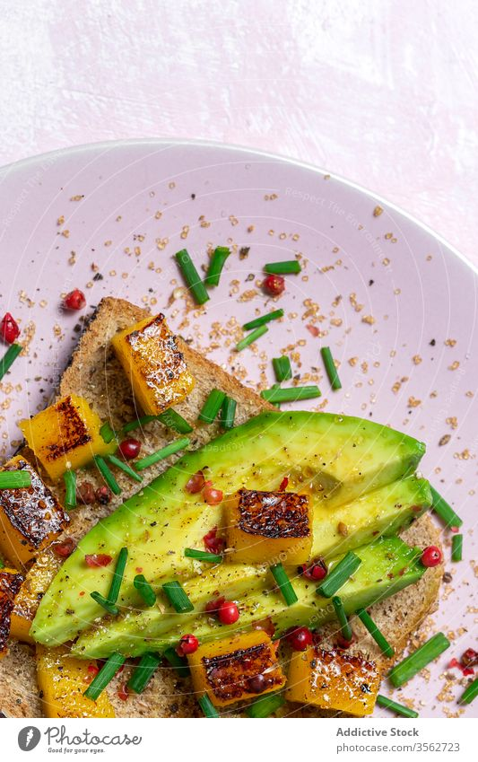 Homemade toasted bread with avocado, mango and aromatic herbs food sandwich healthy lunch snack breakfast meal gourmet vegetarian delicious background slice