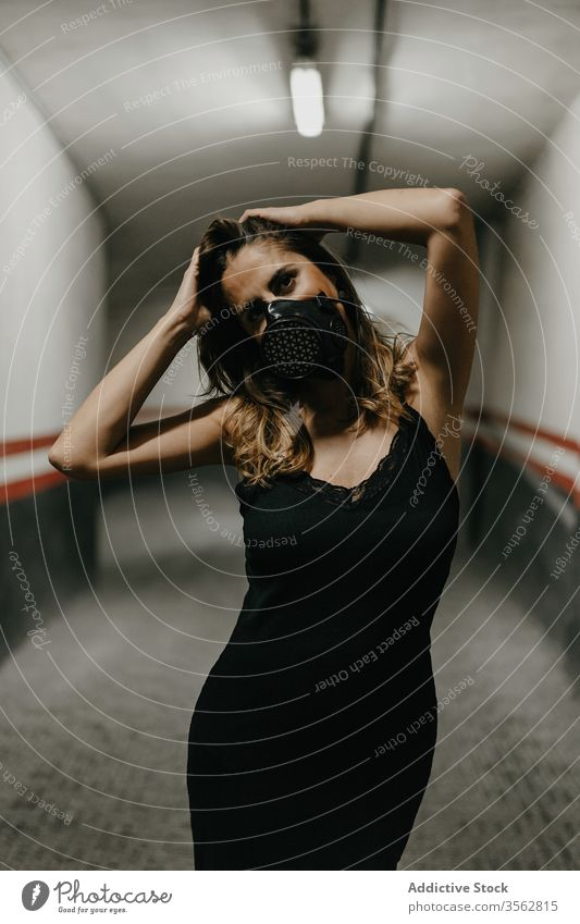 Positive woman in protective mask standing in corridor covid coronavirus prevent positive pandemic concept building safe illness hazard health care cheerful