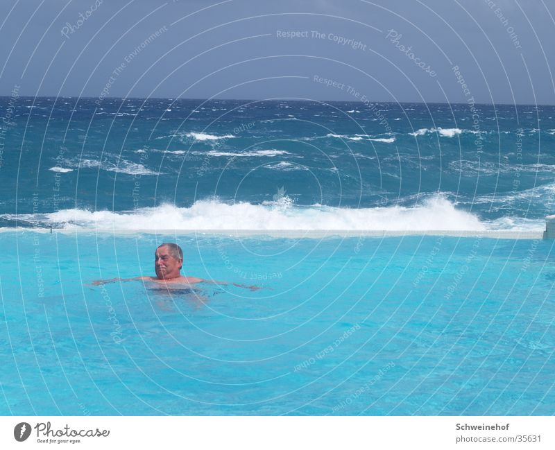 swimming pool Ocean Swimming pool Vacation & Travel Man Male senior Swimming & Bathing Horizon Relaxation Beach vacation Swell Surf Turquoise Wellness Spa