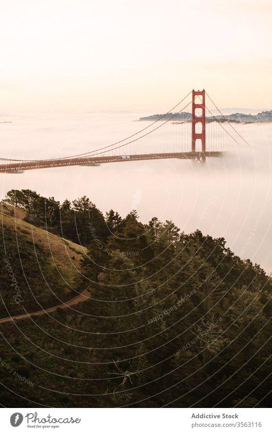 Famous Golden Gate Bridge on foggy evening bridge golden gate sightseeing sunset famous way strait construction architecture landscape sundown destination warm
