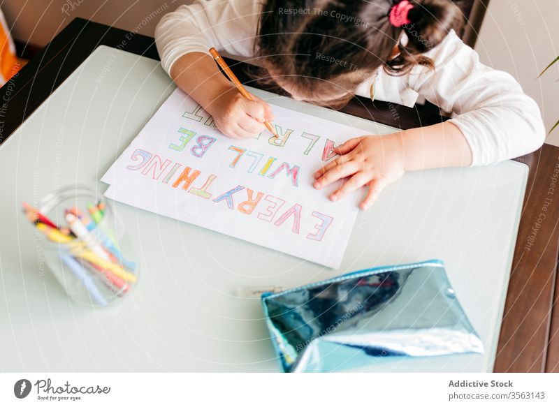 Concentrated little girl drawing with pencil at home table picture kid concentrate develop preschool paint inspiration hobby child creative wooden focus art