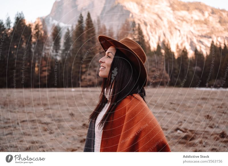 Happy woman enjoying sunny day in mountains travel happy relax forest yosemite park cliff edge rock stone national female style trendy landscape young