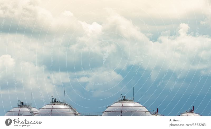 Industrial gas storage tank. LNG or liquefied natural gas storage tank. Spherical gas tank in petroleum refinery. Above-ground storage tank. Natural gas storage industry and global market consumption