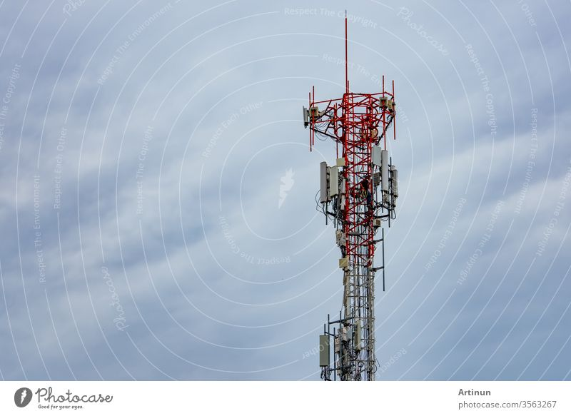 Telecommunication tower with blue sky and white clouds. Worker installed 5g equipment on telecommunication tower.Communication technology. Telecommunication industry. Mobile or telecom 4g network.