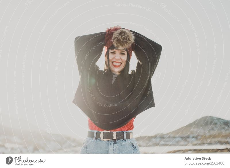 Cheerful woman in sunny winter day at countryside happy cheerful trendy fashion nature outfit style female fun smile casual joy young freedom modern travel