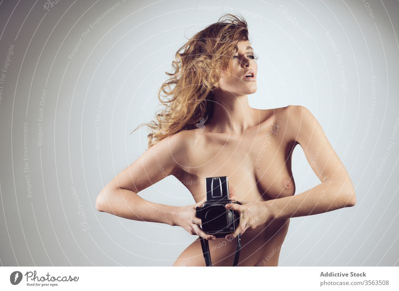 Nude woman with vintage photo camera nude take photo topless sexual naked retro bare female perfect seductive body breast nipple sensual sexy erotic stand model