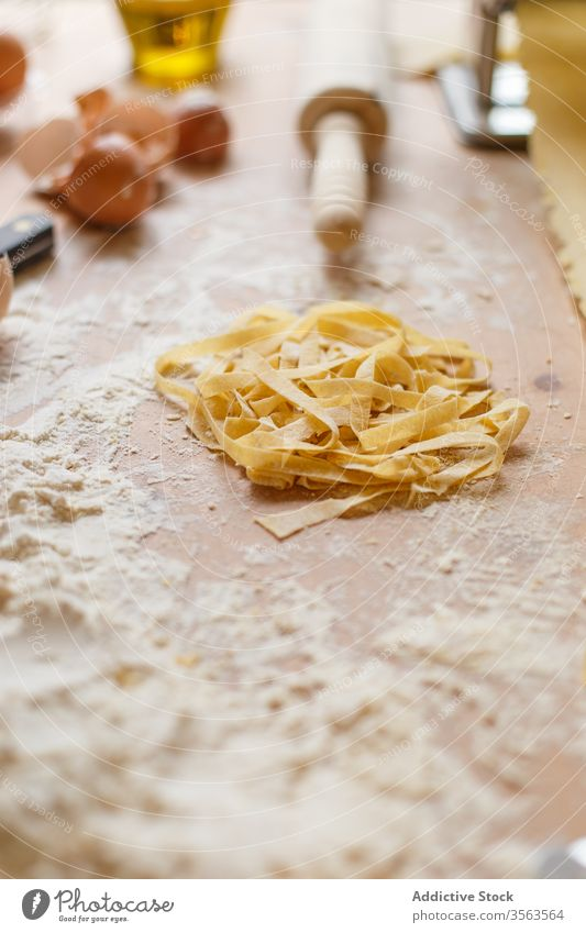 Composition of pasta and kitchenware on table raw flour utensil various shape dough pastry messy make device cookery prepare food spoon daylight gastronomy