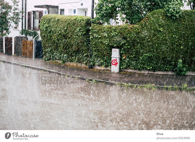 A street in a residential area in heavy rain Rain downpour Empty Street Wet Bad weather Weather Autumn Residential area Sidewalk Strong Gloomy Gray green
