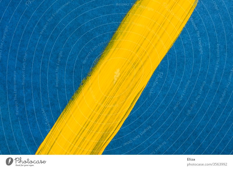 Yellow diagonal brush stroke on a blue background. Graphic. Background. surface Colour Diagonal Brush stroke dash Line Subsoil Divided Abstract unostentatious
