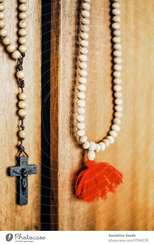 Catholic Rosary and Crucifix hanging on a door Christianity religion church vintage crucifix beads catholic faith prayer rosary wood carving symbolism tradition