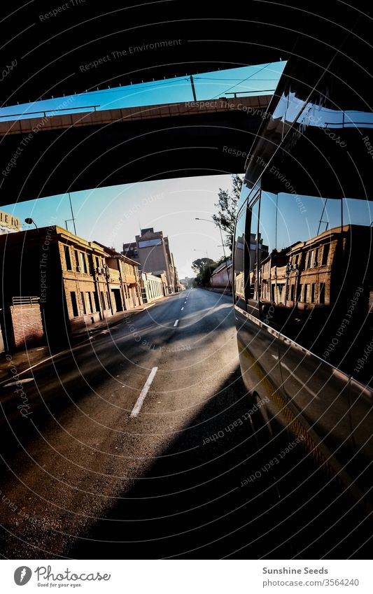 Looking back street view in a quiet city from a mini bus taxi window vehicle shadow 3rd world metro empty tourism trip adventure africa south johannesburg