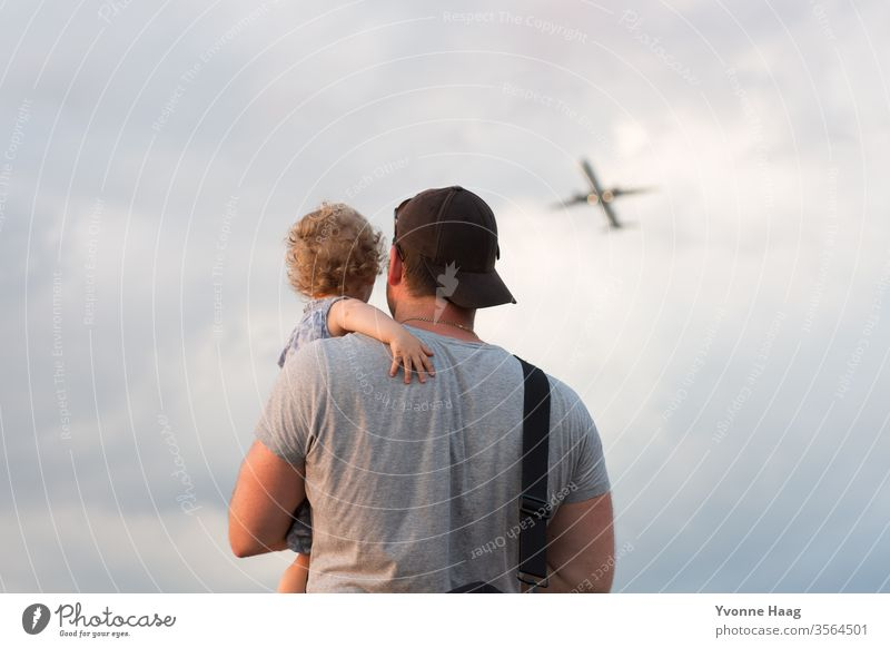Father and child watching an airplane at the Hinmel Beach Sky Coast Clouds Colour photo Nature Wind Exterior shot Landscape Water Bad weather Climate