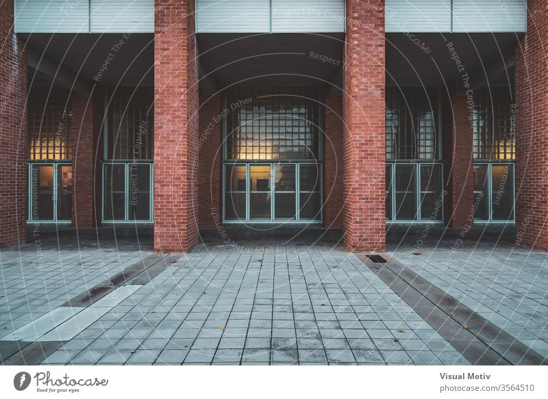 Brick columns and facade of an university building in the afternoon architecture entrance brick modern glass structure construction wall urban town door