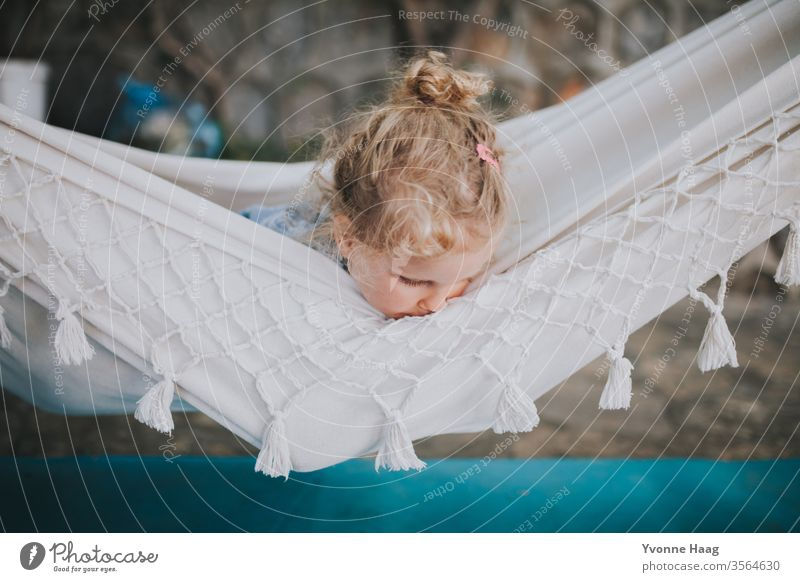 Child lies in a hammock and looks out Hawaii Gale Beach Sky Coast Clouds Colour photo Nature Wind Exterior shot Landscape Storm Water Bad weather Storm clouds