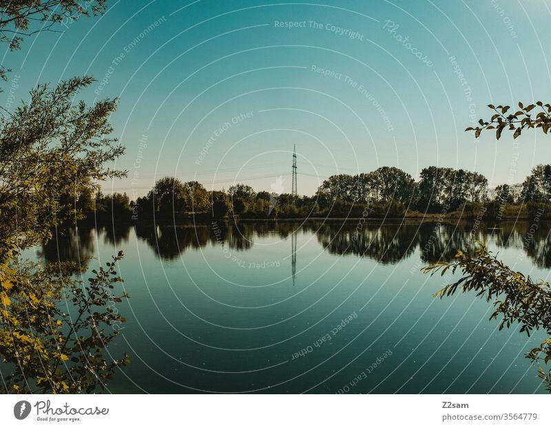 pond Lake Bavaria Blue Nature scavenger huts green Sky Reflection Water Calm Deserted
