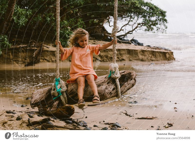Swinging on a big tree trunk Hawaii Hibiscus To swing Rocking Joy Playing Exterior shot Colour photo Playground Infancy Day Child Children's game