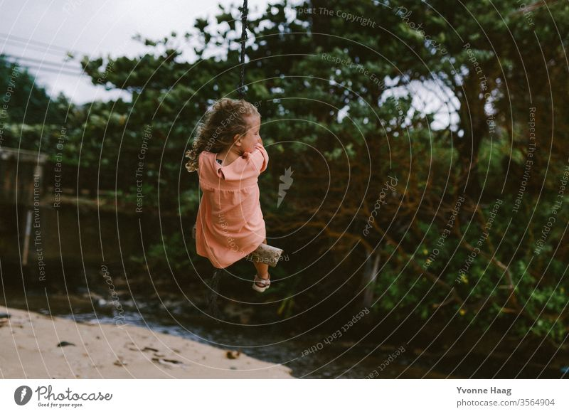 Swinging in Hawaii Hibiscus To swing Rocking Joy Playing Exterior shot Colour photo Playground Infancy Day Child Children's game Copy Space right Movement