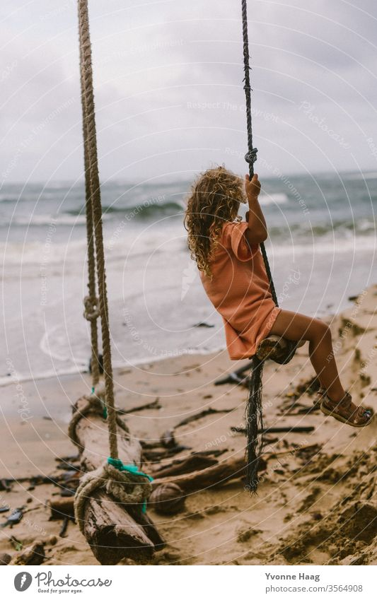 Swinging towards the sea Hawaii Hibiscus To swing Rocking Joy Playing Exterior shot Colour photo Playground Infancy Day Child Children's game Copy Space right