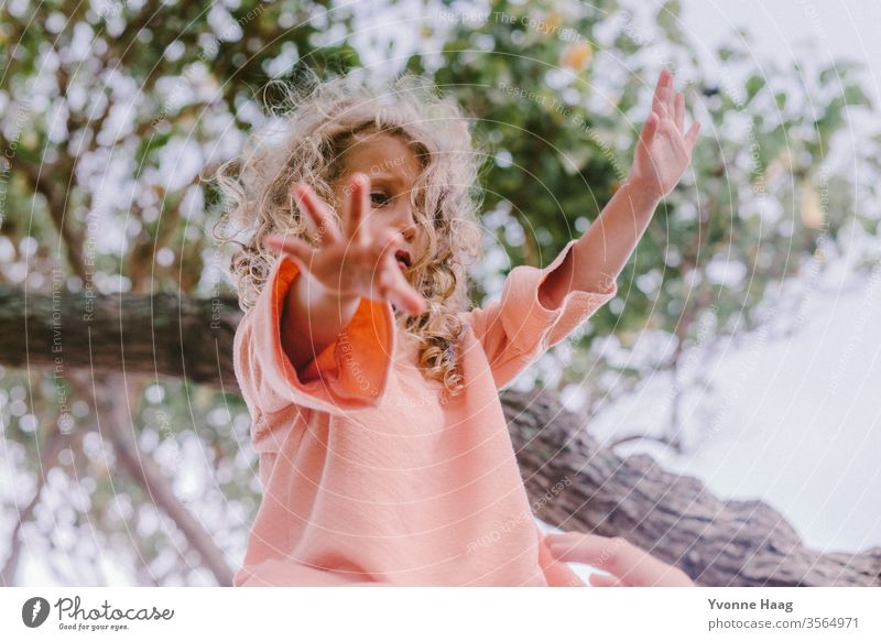 Girls with open arms Hawaii Hibiscus To swing Rocking Joy Playing Exterior shot Colour photo Swing Playground Infancy Day Child Children's game Copy Space right