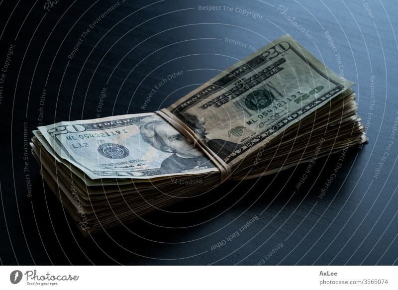 Money on the table money dollar currency cash business finance wealth dollars isolated paper bill hundred bank stack banking bills usa 100 savings white green
