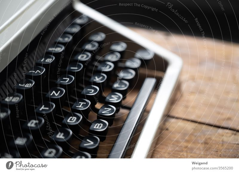 typewriter Typewriter Literature Writer Novel Keyboard Letters (alphabet) Typing Retro office work Desk Paper Text Machinery Letter (Mail) Book