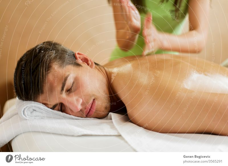 Massage massage wellness health man care beauty treatment spa body therapy luxury hand relaxation male adult skin young rest lifestyle pampering back people