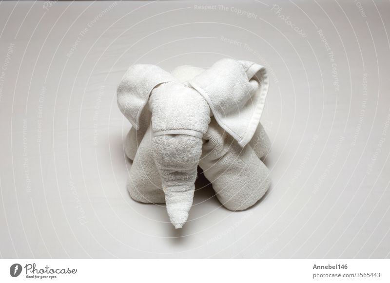 Beautiful elephant figure rolled from hotel towels on the bed, Hotel Towels on Bed clean and new background beach spa summer nature massage animal fabric