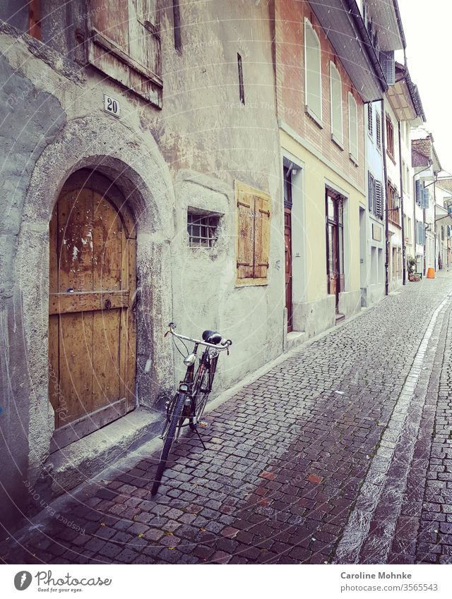 Alley in Solothurn Switzerland by bike Bike Bicycle Swiss Exterior shot Colour photo Deserted Summer Landscape Tourism Vacation & Travel Europe Sky Old Moody