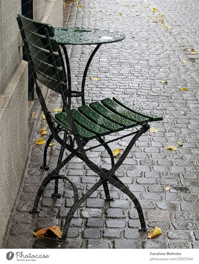 Green bistro chair and table left in the rain Chair Table Bistro table Living or residing Colour photo Day Deserted Exterior shot Furniture Decoration Esthetic