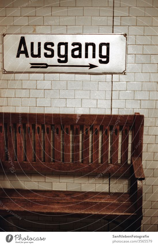 Ausgang in U-Bahn Berlin Subway station exit Exit route Bench Way out Arrow Direction Wall (building) Characters Colour photo Signs and labeling Signage Germany
