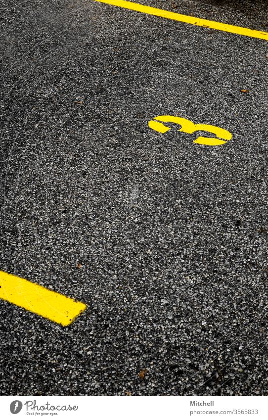 Bold Parking Spot with the Number Three bold yellow background parking spot parking lot number number three lines contrast Digits and numbers