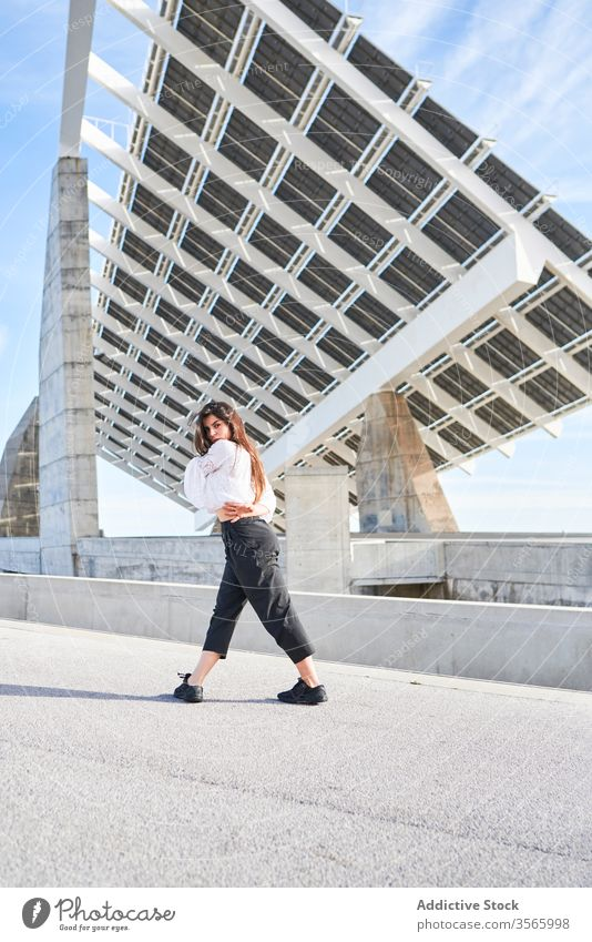 Woman dancing on modern building woman dancer ballerina contemporary concept high concrete person urban fly female construction street motion architecture
