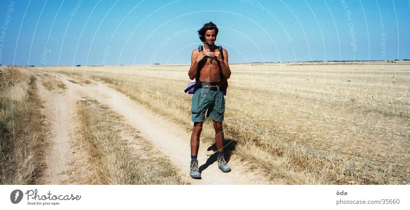 Man Sky Loneliness Far-off places Lanes & trails Landscape Hiking Steppe Drought Endurance Backpack Human being