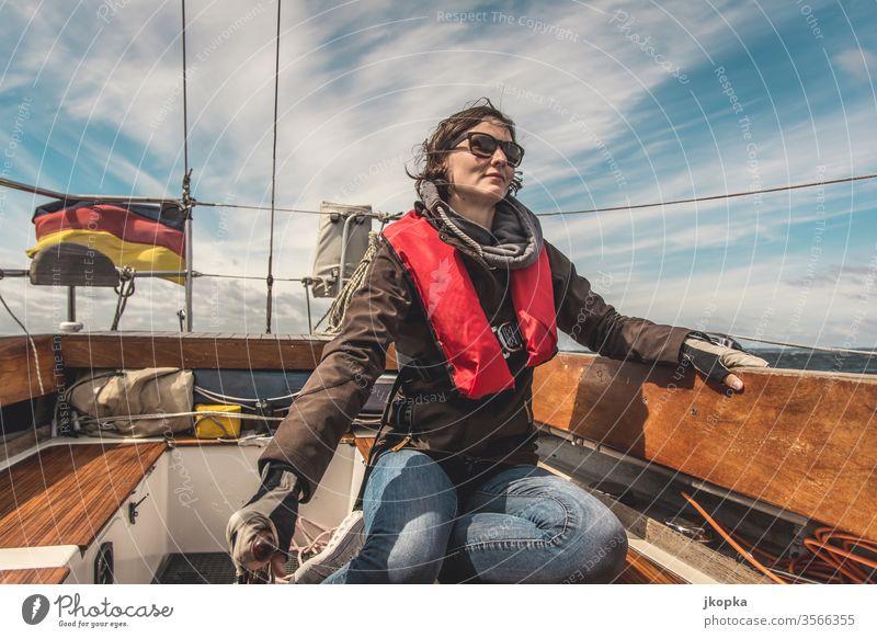Young woman sailing on the Baltic Sea Sailing Woman boat yacht Yacht Sailboat Adventure Water vacation ship Nautical travel Sailing ship Exterior shot Deck