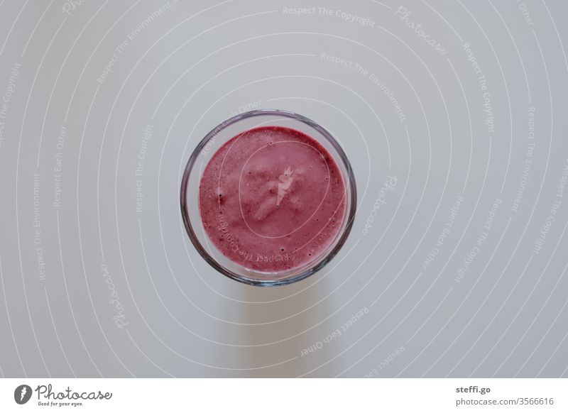 pink juice in a glass on a neutral background from a bird's eye view Drinking food and drink Healthy Healthy Eating salubriously smoothie Pink Red Food