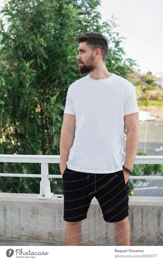 Casual model man outdoors, Very handsome, with a white t-shirt and urban style portrait young happy smiling person people park casual smile guy face men beard