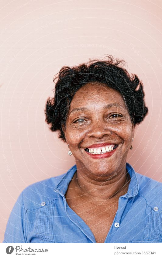 smiling cuban lady, cuba blue face people portrait one people nice pretty pink wall caribbean island cuban woman grandmother street real people lifestyle