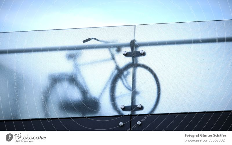 Bike behind parapet Bicycle hollandrad bridge Frosted glass Sports