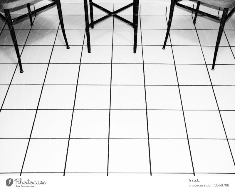 chic tiles - nice legs - nice chairs - chic table Table cake floor Deserted Chair Tile Living or residing Flat (apartment) Interior shot Shadow