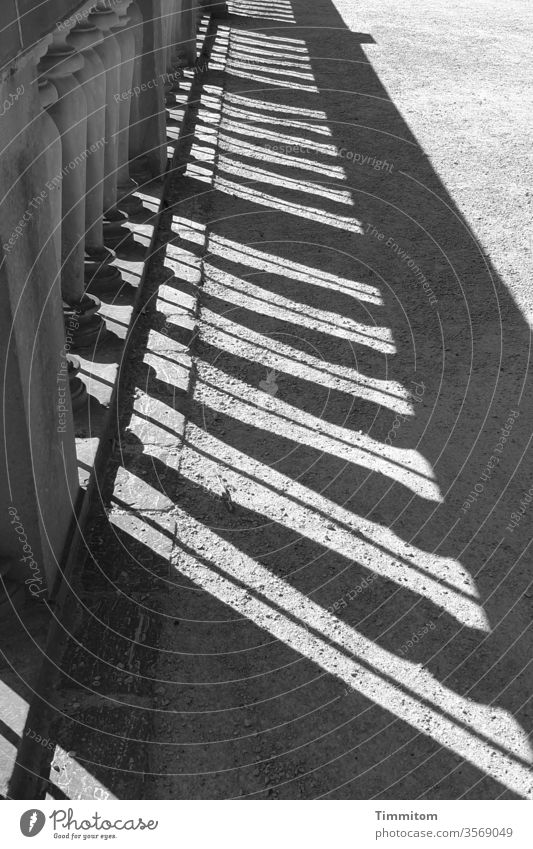 Strict order Handrail cordon Shadow Sandstone Metal lines Lanes & trails off Exterior shot Deserted Safety Light Black & white photo