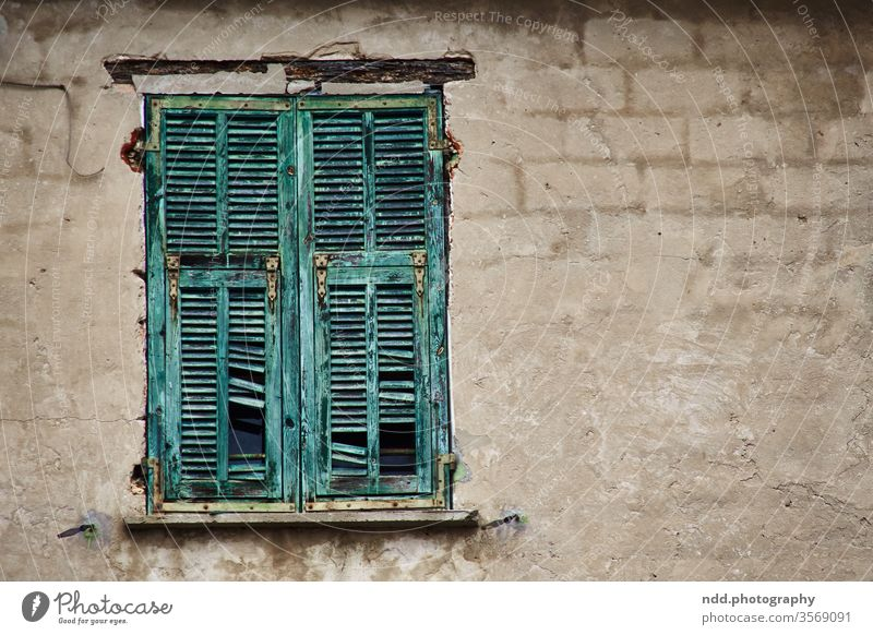 Derelict shutter on unplastered wall Window shutters Facade Old Decline Wall (building) derelict house Broken Transience Colour photo Deserted Subdued colour